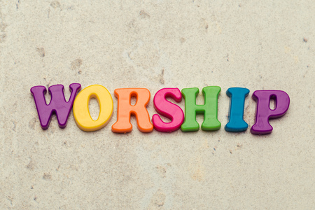 The word Worship written in plastic colorful letters
