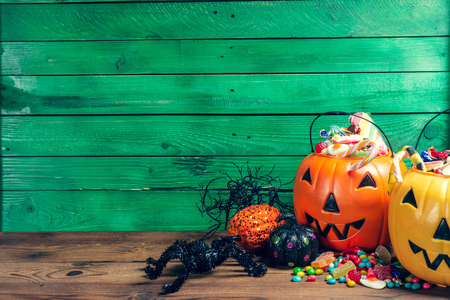 Happy halloween! Pumpkin with candy in the home. Stock fotó