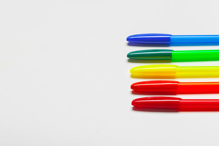 different colors pens isolated on the white background