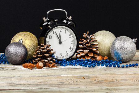 Composition with retro alarm clock and Christmas decoration