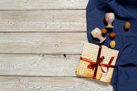 Jewish holiday Passover banner design with wine, matzo on wooden background. Stok Fotoğraf
