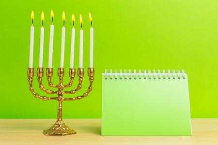 Bronze Hanukkah menorah with burning candles Stock Photo