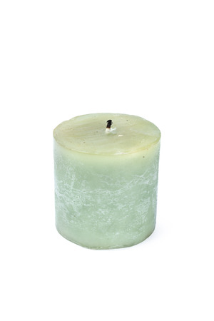 A pillar candle isolated on a white background Imagens