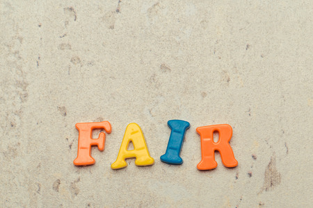 Plastic colorful letters with the text: Fair close up