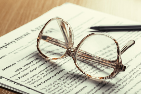 Close up shot of Eyeglasses  on document papers business concept Stock fotó - 111877055