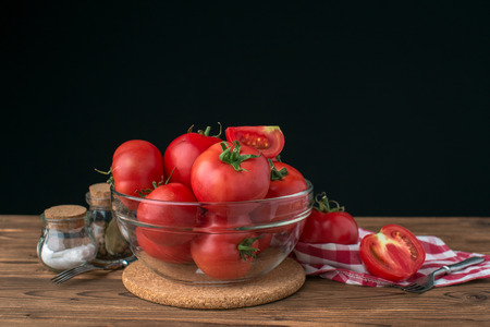tomatoes on wooden background Stok Fotoğraf