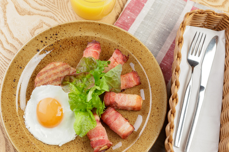 English breakfast. Fried egg and bacon rolls close up Stock Photo