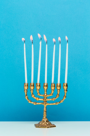 Bronze Hanukkah menorah with burning candles Zdjęcie Seryjne