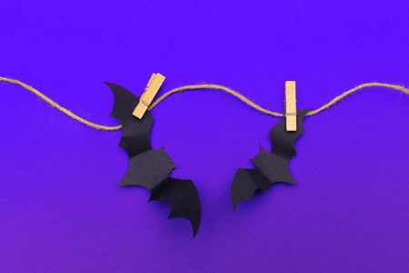 halloween and decoration concept - paper bats flying