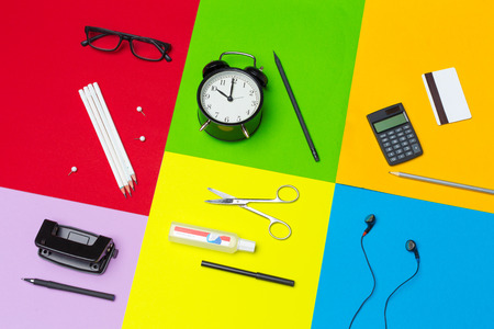 school supplies at colorful paper background 写真素材