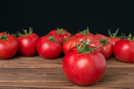 tomatoes on wooden background Stock fotó