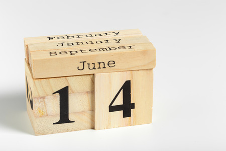 Wooden cubes with date on white background. 14th of June