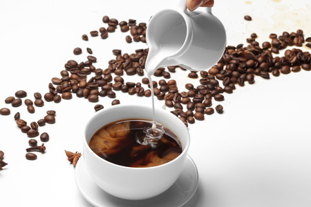 Coffee bean small cup full of coffee bean isolated on white 免版税图像