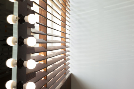 Wooden blinds with sun light in a house room Stockfoto - 112767397