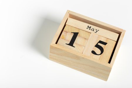 Wooden cubes with date on white background. 15th of May