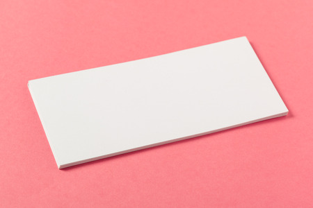 Blank paper pieces  on a colored pink background Stockfoto