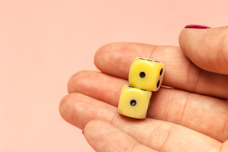 hand with a pair of dice