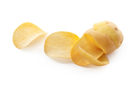 crispy chips and raw potato on white background