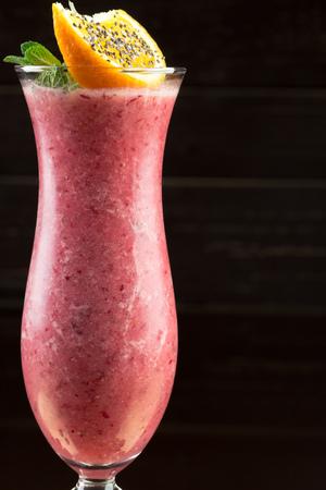 Strawberry smoothie on dark background