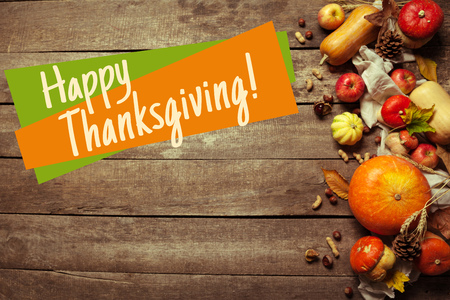 Happy thanksgiving day display on wooden background