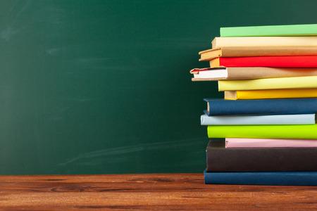 Books on Desk, Chalkboard Background