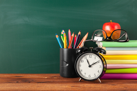 back to school - apple and books with pencils and blackboard Stock Photo