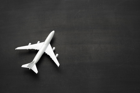 Miniature airplane on black background Stock Photo