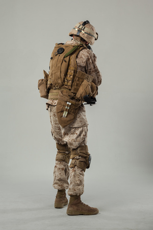 Soldier in camouflage holding rifle 写真素材