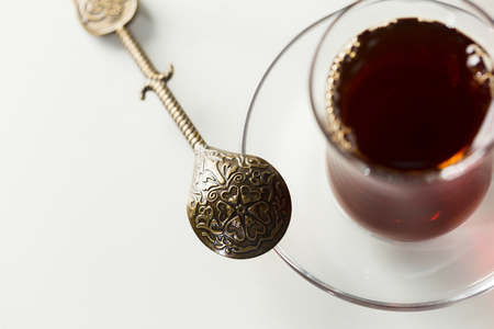Turkish tea in traditional glass isolated on white background Фото со стока