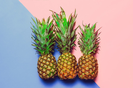 pineapple on colored paper Standard-Bild - 120433157