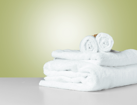 Stack of folded white spa towels Standard-Bild - 120433159