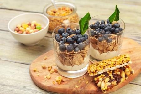 Granola, yogurt and strawberries in a jars 写真素材