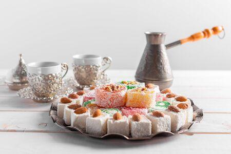 Turkish delight on a wooden table. creative photo Foto de archivo