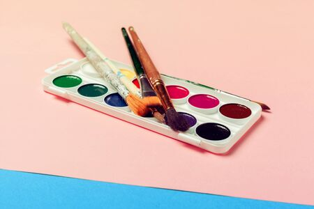 Top view of Work Process Blank Watercolor Paper Watercolor Painting Supplies Brushes. creative photo