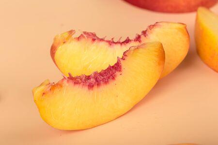 Ripe peach fruit slice. Creative Photo