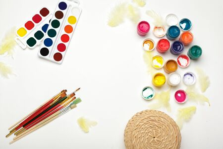 Top view of Watercolor Painting Supplies, Brushes and Colorful Pencil. Creation process of watercolor painting. Copy space.