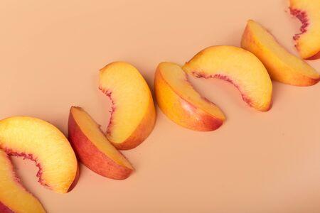 Ripe peach fruit slice close up. Creative Photo