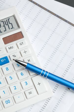 Business still life with calculator on table in office. creative photo.
