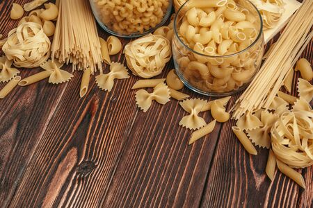 Various types of Italian pasta rustic background. creative photo.