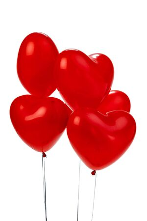 Air Balloons. Bunch of red heart shaped foil balloons. creative photo.