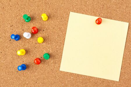 note paper pined on brown cork board background Reklamní fotografie