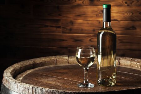 Wine bottles with glass, wooden background. creative photo.