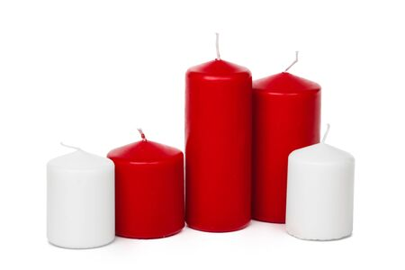 Red and white colored xmas candles isolated on white background Stock Photo