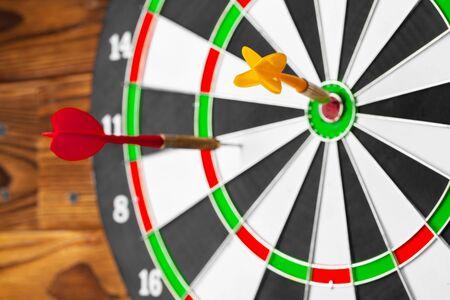 The darts on wooden background. Creative photo. 版權商用圖片