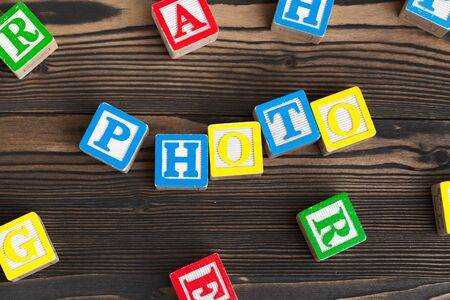 Alphabet blocks ABC on wooden table. Text- photo
