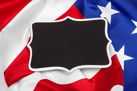 Blank frame on American flag background Фото со стока - 140958591