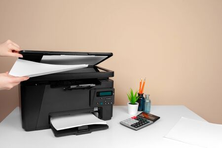 Woman using the printer to scanning and printing document. creative photo.