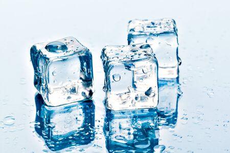 ice cubes on white background. Creative photo.