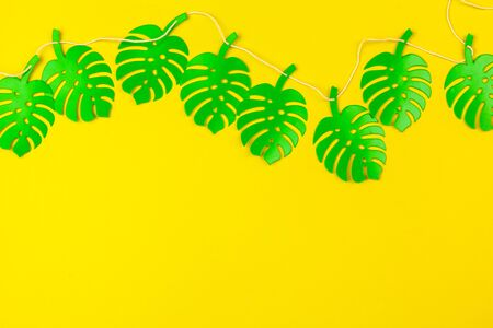 Summer Tropical leaves, plants Frame. Paper cut style. creative photo.