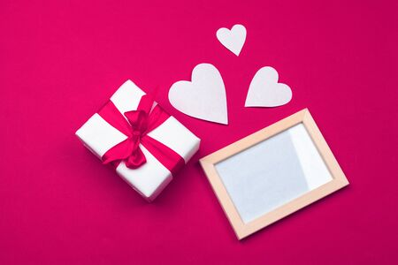 Valentines day greeting card. gift box on red table. Top view with copy space. Creative photo.